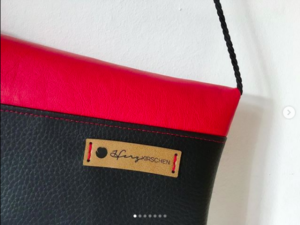 Clutch in rot/schwarz